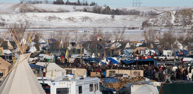 On Sunday, protesters gather at their camp as news breaks that the Army Corps of Engineers will not approve an easement for the Dakota Access Pipeline.