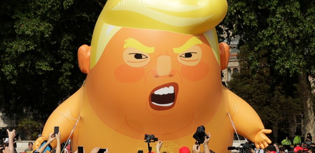six-meter high cartoon baby blimp of U.S. President Donald Trump is flown as a protest against his visit, in Parliament Square in London, England, Friday, July 13, 2018. Trump is making his first trip to Britain as president after a tense summit with NATO leaders in Brussels and on the heels of ruptures in British Prime Minister Theresa May's government because of the crisis over Britain's exit from the European Union.