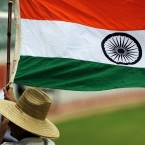 A cricket fan waves the flag of India in 2012. Moviegoers in the country should expect to see much more of it when they catch the latest blockbuster.