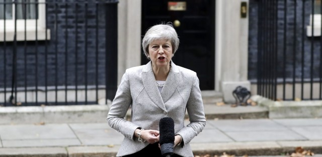 "Britain's Prime Minister Theresa May makes a statement outside 10 Downing Street, London on Thursday. May says the Brexit deal's approval ""is within our grasp,"" and she is determined to deliver it."