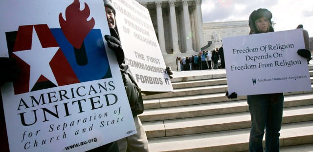 Activists hold posters during a March 2005 rally in front of the U.S. Supreme Court to support separation of church and state