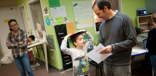 Rob Huge gives feedback to his son, Thomas, 9, a student at Greenfields.