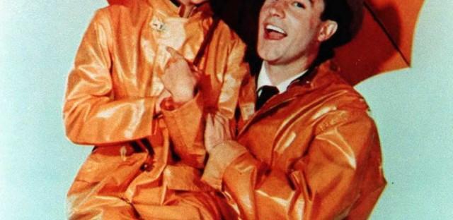 Gene Kelly and Debbie Reynolds from the movie <em>Singin' in the Rain</em>.