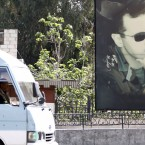 "A minivan drives past a portrait of Syrian President Bashar Assad in Damascus last week. U.S. forces fired a barrage of cruise missiles at a Syrian air base Thursday in response to what President Trump called a ""barbaric"" chemical attack he blamed on the Assad regime."