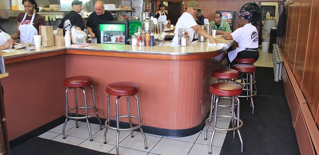 The vintage wrap-around counter inside Moon's Sandwich Shop on the West Side.