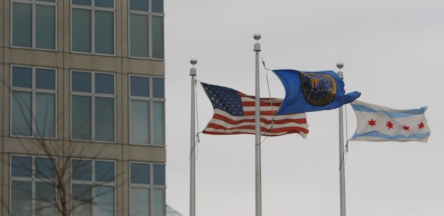 The FBI flag, center, flies between a U.S. flag and a City of Chicago flag at the FBI building in Chicago, on Thursday, Nov. 6, 2008.