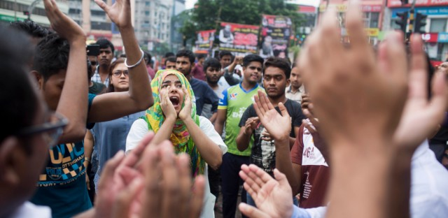 Bangladeshi students shout slogans as they block a road during a protest in Dhaka, Bangladesh, Thursday, Aug. 2, 2018. Students blocked several main streets in the capital, protesting the death of two college students in a bus accident in Dhaka.