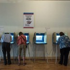 Early voters cast ballots at a center in Minneapolis on Oct. 5. This will be the first election since the 1965 Voting Rights Act in which federal observers will not be stationed in polling places.