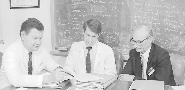 Unidentified officers in the Epidemic Intelligence Service of the Centers for Disease Control and Prevention conduct AIDS research in 1973. Since 1951, the Epidemic Intelligence Service played a pivotal role in combating the root causes of major epidemics throughout the world.