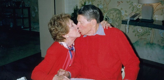 Former President and Mrs. Reagan kiss during his 89th-birthday celebration on Feb. 6, 2000, at their home In Bel Air, Calif.