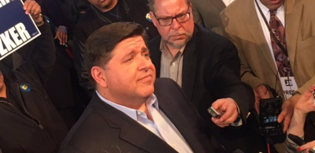 J.B. Pritzker talks with reporters Thursday after announcing he is running for governor at the Grand Crossing Gym on the South Side.