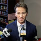 Former U.S. Rep. Aaron Schock, R-Ill. speaks to reporters in Peoria, Ill. in 2015.  (AP Photo/Seth Perlman, File)