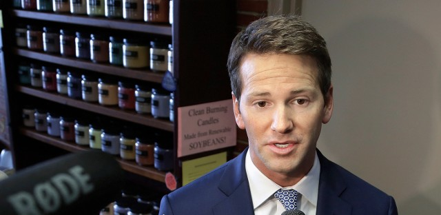 Former U.S. Rep. Aaron Schock, R-Ill. speaks to reporters in Peoria, Ill. in 2015.