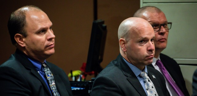 Chicago police Officer Thomas Gaffney, from left, former Officer Joseph Walsh, and ex-Detective David March attend a pretrial hearing Nov. 15. They face charges of obstruction of justice, official misconduct, and conspiracy. The trial begins on Tuesday.