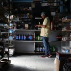 A person visits a Miami store that doesn't have electricity on Tuesday. Much of Florida was without power two days after Hurricane Irma battered the state.