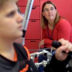 In this Dec. 16, 2013, photo, Erin Cunningham watches her 11-year-old son Jackson, as he uses an Armeo spring pediatric occupational therapy devise to build strength and mobility in his left hand and arm at the Rehabilitation Institute of Chicago. Jackson suffered a stroke in 2011 that paralyzed much of the left side of his body. Jackson's story of determination and recovery has been a source of inspiration for many, including U.S. Sen. Mark Kirk, who became pen-pals with the Oakwood boy following his own January 2012 stroke. (AP Photo/M. Spencer Green)