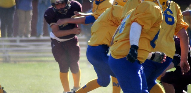 Should my kid play football? A sports reporter – and mom – weighs in