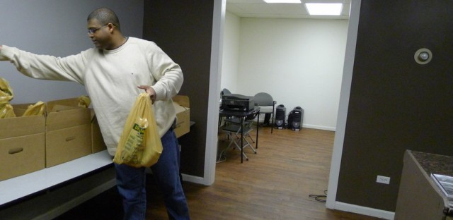 Homer Bizzle reorganizes his small food pantry for veterans.