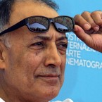 """Acclaimed Iranian film director Abbas Kiarostami poses during the photo call of his movie 'Shirin' at the Venice Film Festival.  Kiarostami, whose 1997 film """"Taste of Cherry"""" won the Palme d'Or, died Monday, July 4, in Paris, where he had gone for cancer treatment."""