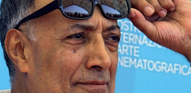 "Acclaimed Iranian film director Abbas Kiarostami poses during the photo call of his movie 'Shirin' at the Venice Film Festival.  Kiarostami, whose 1997 film ""Taste of Cherry"" won the Palme d'Or, died Monday, July 4, in Paris, where he had gone for cancer treatment."