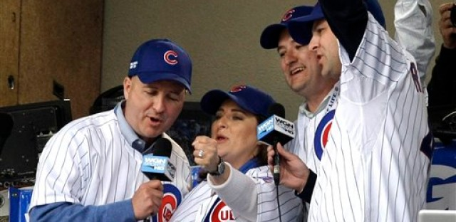 "Laura Ricketts, second from left, with her family members singing ""Take Me Out to the Ball Game"" during a game at Wrigley Field."