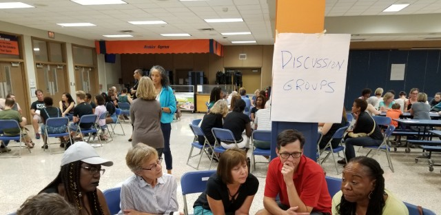 People gather in the Oak Park and River Forest High School cafeteria to discuss their reactions to the new documentary that was filmed at the school. It raises questions about how black students in particular are treated at the school, which is considered high performing, diverse and progressive.