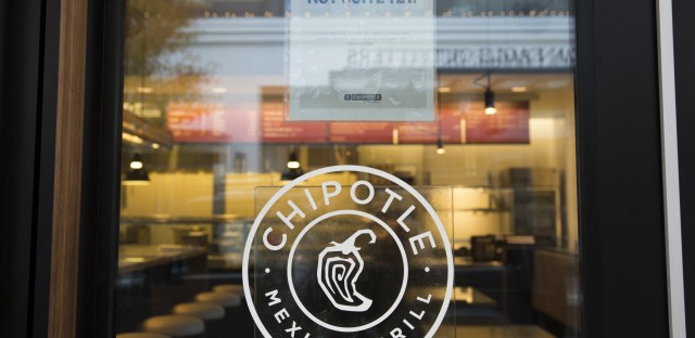 """A sign saying """"we hope to be opening soon"""" is pictured outside a new Chipotle Mexican Grill location at University Village in Seattle in November."""