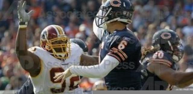 Jay Cutler (6) throws under pressure from Washington Redskins' Albert Haynesworth (92). (AP Photo/Charles Rex Arbogast)