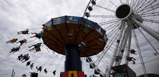 People ride a wave swinger at Chicago's Navy Pier, Friday, June 21, 2019.