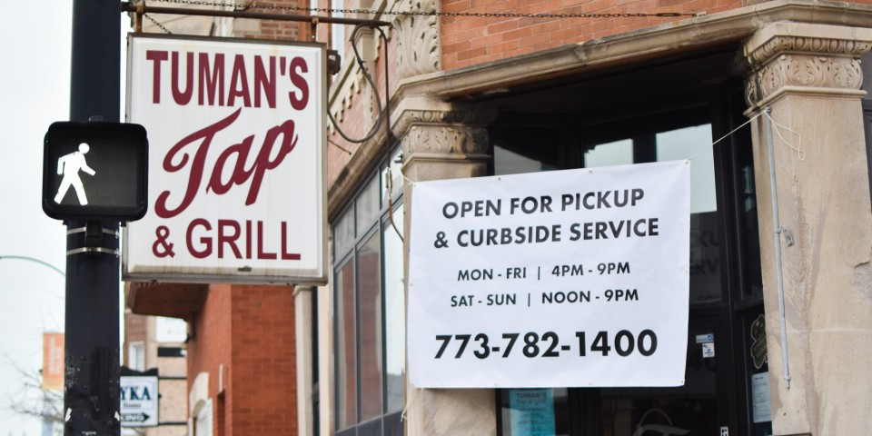 photo of sign outside of Tuman's Tap and Grill
