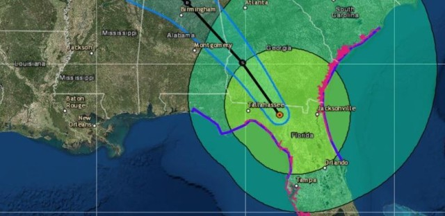 Irma is now a tropical storm — but it still poses severe flooding threats across Florida and into neighboring states. The storm's predicted path is seen here in forecasters' 11 a.m. ET release.