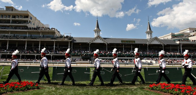 The University of Louisville's marching band leaves the Churchill Downs infield after performing the state song at the Kentucky Derby.