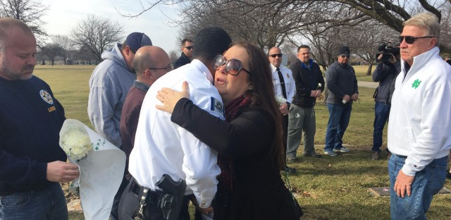 Yvonne Yaros hugs Gary Police Chief Larry McKinley as her husband Tim Yaros, right, looks on. Tim Yaros' father was gunned down while responding to a bank robbery in Gary in 1981. His killer was released from prison on Feb. 2, 2017.
