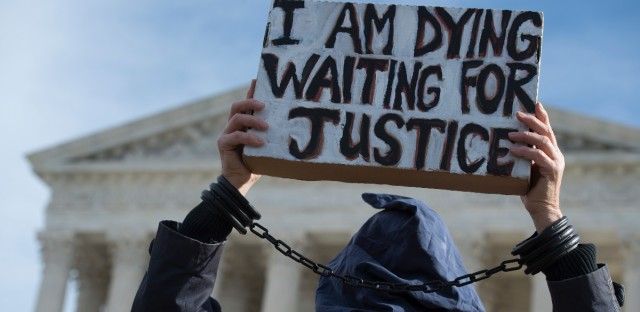Protesters with Witness Against Torture participate in a rally at the Supreme Court in Washington, Wednesday, Jan. 11, 2017, calling for the closing of the Guantanamo Bay prison.