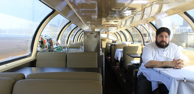 Chef Daniel Traynor sits aboard a refurbished Pullman car before setting off to New Orleans.