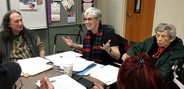 Janet Hoult (center) teaches a poetry workshop in Southern California.