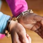 handcuffed girl student