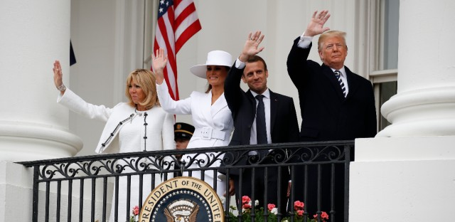 President Donald Trump, French President Emmanuel Macron, first lady Melania Trump and Brigitte Macron wave from the balcony of the White House during a State Arrival Ceremony at the White House in Washington, Tuesday, April 24, 2018.