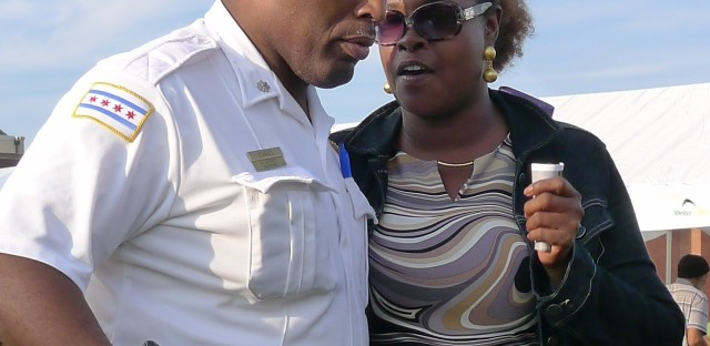 Evans, 52, listens to a Harrison District resident Tuesday at a National Night Out event.