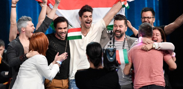 Hungary's Freddie celebrates with his team after qualifying in the first Eurovision Song Contest semifinal in Stockholm, Sweden, Tuesday, May 10, 2016.