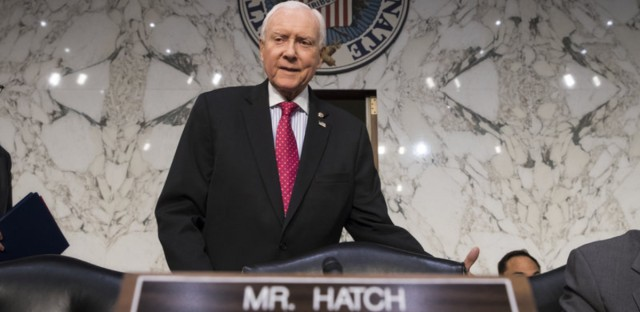 Senate Finance Committee Chairman Orrin Hatch, R-Utah, arrives as the tax-writing panel began work on overhauling the nation's tax code on Nov. 13. (J. Scott Applewhite/AP)