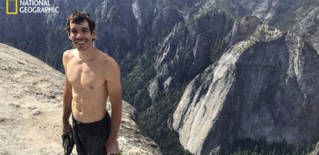 Alex Honnold smiles after scaling El Capitan in Yosemite National Park, in a photo provided by National Geographic. Honnold became the first person to climb alone to the top of the massive granite wall without ropes or safety gear. (Jimmy Chin/National Geographic via AP)