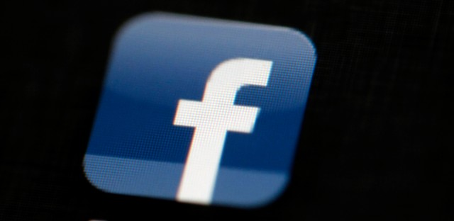 """In this May 16, 2012 file photo, the Facebook logo is displayed on an iPad in Philadelphia. Facebook is under fire after a report from a Gawker site accused it of manipulating its """"trending topics"""" feature to promote or suppress certain political perspectives. Facebook has denied the claims, but the GOP-led U.S. Senate Commerce Committee has sent a letter to Facebook and CEO Mark Zuckerberg requesting answers about the matter."""