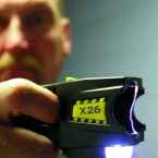 A Taser is shown making an electrical arc between its two electrodes