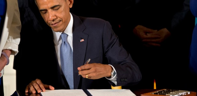 President Barack Obama signs executive orders to protect LGBT employees from federal workplace discrimination in 2014.