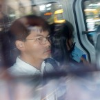 Pro-democracy activists Joshua Wong, left, and Agnes Chow, are escorted in a police van at a district court in Hong Kong, Friday, Aug. 30, 2019. Hong Kong police arrested well-known activist Wong and Chow, another core member of a pro-democracy group, Friday, and authorities denied permission for a major march in what appears to a harder line on this summer's protests.