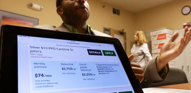 A health navigator sits behind a laptop displaying the Affordable Care Act marketplace.  AP/File