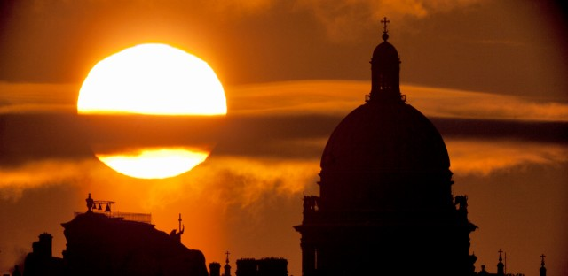 The city landmark, St. Isaak's Cathedral is silhouetted as the sun sets in St. Petersburg, Russia, Saturday, Jan. 15, 2011.