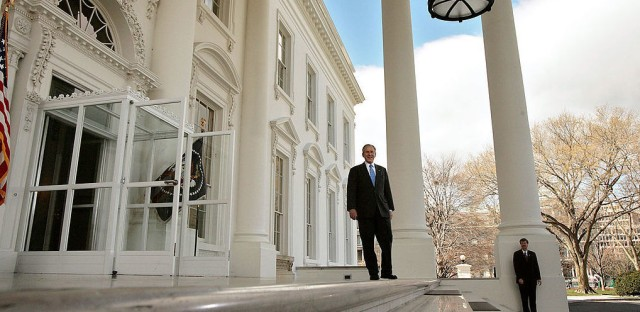 President George W. Bush waits on the North Portico for the arrival of Republican presidential nominee Sen. John McCain at the White House on March 5, 2008.