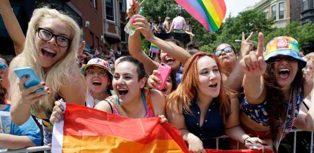 People celebrate at the 46th Annual Chicago Pride Parade, Sunday, June 28, 2015, in Chicago. A large turnout was expected for gay pride parades across the U.S. following the landmark Supreme Court ruling that said gay couples can marry anywhere in the country.